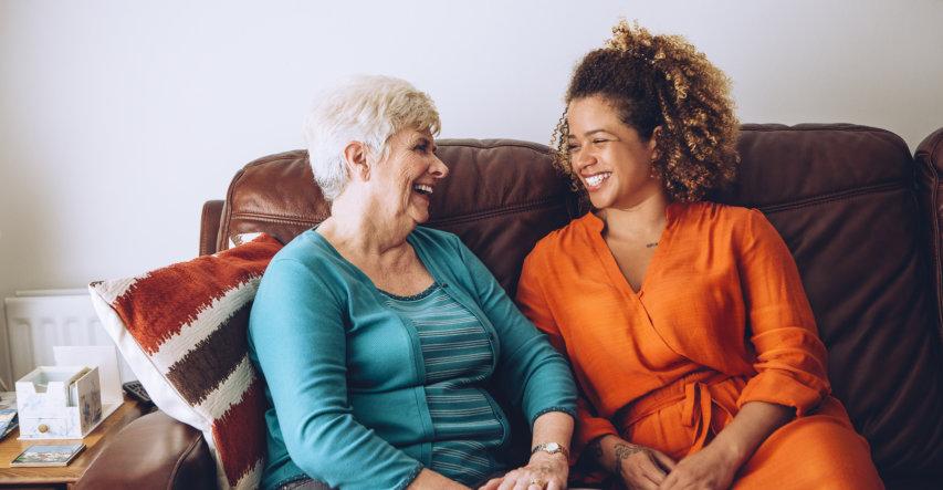 nurse assisting elderly woman in walking