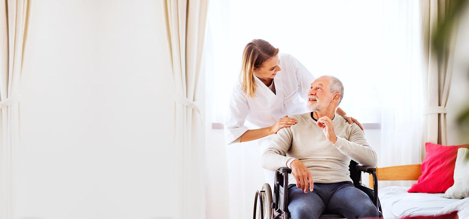 caregiver taking care of her elderly patient
