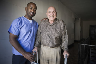caregiver and man in crutches smiling