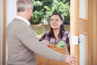 caregiver handling groceries to her patient